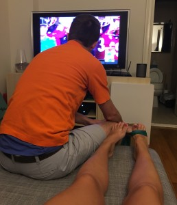 Eric helping with my PT exercises...while watching football