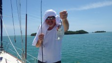 Dad with fish and fancy sun head dress