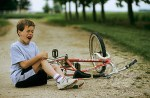 Little Boy Crying A Path Near His Bike
