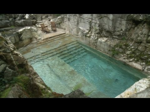 Rock Quarry Turned Into Luxurious Home Swimming Pool