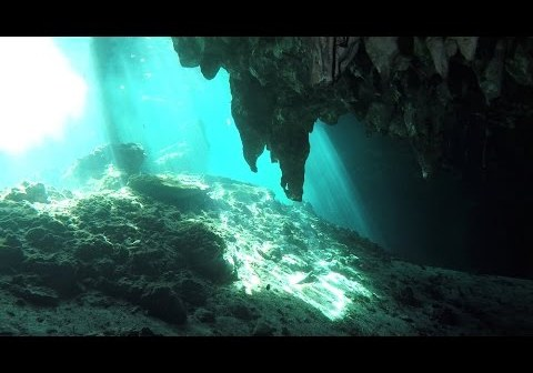 Freediver/Scuba Diver Exploring Mystical Underwater Caves