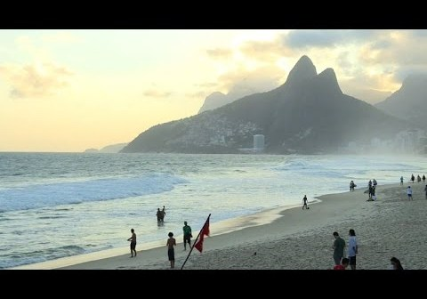 Olympic broadcasting building flooded as ocean swell swamps street along Rio's Copacabana beach