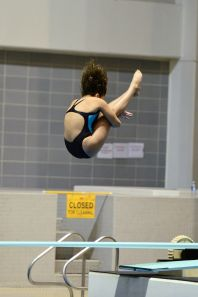 KNOXVILLE, TN - July 31, 2014: Mary Warker dives from the 1 meter springboard during the 2014 USA Diving Age Group and Junior National Event at Allan Jones Aquatic Center in Knoxville, TN. Photo By Matthew S. DeMaria