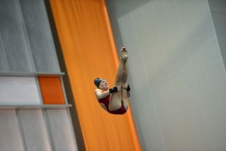 KNOXVILLE, TN - July 31, 2014: Mikaela Lujan dives from the platforms during the 2014 USA Diving Age Group and Junior National Event at Allan Jones Aquatic Center in Knoxville, TN. Photo By Matthew S. DeMaria