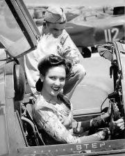 linda-darnell-wearing-victory-rolls-in-plane