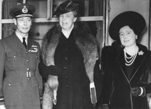 Eleanor Roosevelt stands between King George VI and Queen Elizabeth during an inspection of English war conditions in 1942