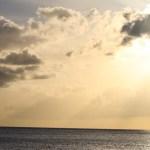 Spinnvill, det karibiske hav og solnedgang