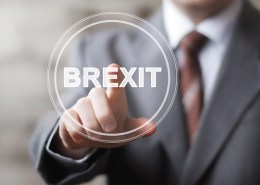 Businessman hand press button Brexit icon