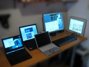 several computers on a desk