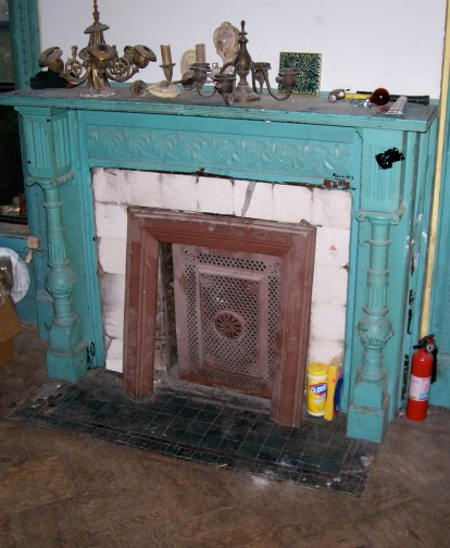 Greene St. Brownstone-Original condition of the fireplace and hearth.