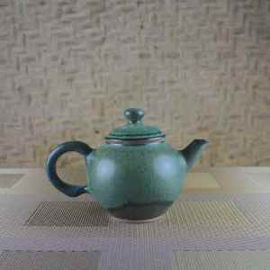 Small Moondust Green Teapot with Blue Handle Side View