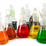 40681716 - isolated image of different laboratory glassware with color liquid on a white background