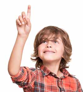 30959415 - cool young boy pointing to empty space over white