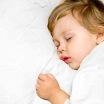 10790738 - portrait of a close-up, infant lying on the bed