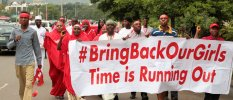 "Campaigners from ""#Bring Back Our Girls"" march during a rally calling for the release of the Abuja school girls who were abducted by Boko Haram militants, in Abuja"
