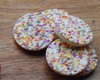 white chocolate disks with sprinkles