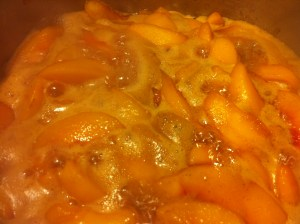 Beginning to boil the peaches.