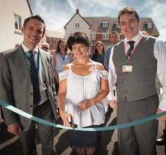 Representatives from housing association provider Stonewater, Swindon Borough Council and Mi-space (UK) Ltd at the opening of a new housing development of 48 affordable homes in St Quentin Close, Swindon.   L to R - Johnathan Layzell, Executive Director of Development at Stonewater, resident Tracy Fitton and Cllr Oliver Donachie.  Picture by Clint Randall www.pixelprphotography.co.uk