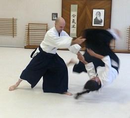 Mick throws Elizabeth
