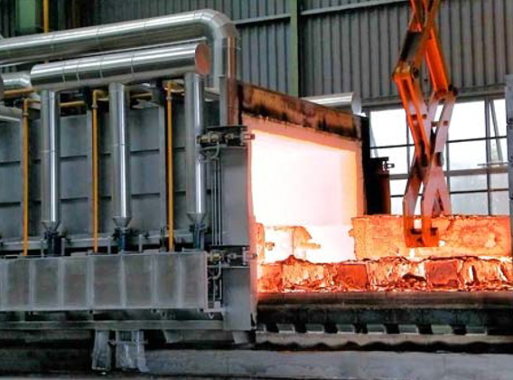 Moving hood reheating furnace for forging