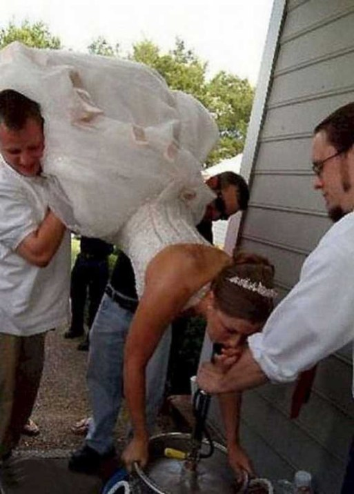 bride doing keg stand drunk bride Funny Wedding Photos, Bad Wedding Photos, wedding photography, wedding dresses, wedding receptions, wedding chapels, honeymoon destinations, wedding cakes, keg stand, wedding toppers,