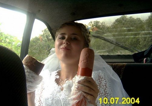 bride with sausage drunk bride Funny Wedding Photos, Bad Wedding Photos, wedding photography, wedding dresses, wedding receptions, wedding chapels, honeymoon destinations, wedding cakes, wedding toppers,