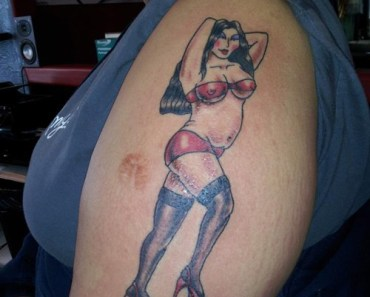 woman tattoo Worst Tattoos funny pictures bad tattoos terrible awful ugliest tattoos wtf tattoos, horrible stupid awkward family photos crazy babe