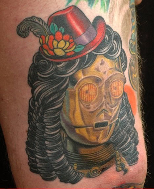 C3PO with wig and hat Bad Star Wars Tattoos, Worst Star Wars Tattoos, ugliest tattoos, funny tattoos, star wars convention, ugliest tattoos, worst tattoos in america, stupid people, funny pictures, wtf, fail, crazy, horrible, terrible, regrettable, regrets, awful ugly