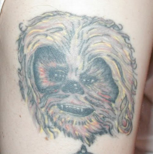Chewbacca looks like a dog Bad Star Wars Tattoos, Worst Star Wars Tattoos, ugliest tattoos, funny tattoos, star wars convention, ugliest tattoos, worst tattoos in america, stupid people, funny pictures, wtf, fail, crazy, horrible, terrible, regrettable, regrets, awful, ugly