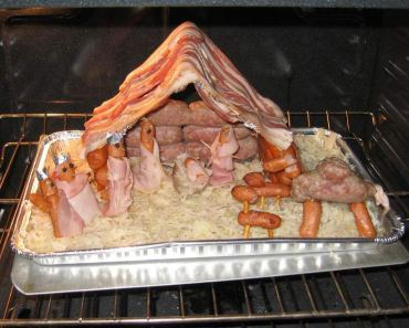 Sausage Bacon Meat Nativity Scene in oven