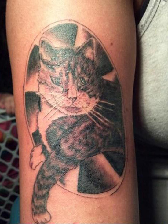 Drunken regrets 16 of the worst bad tattoos team jimmy joe for Bad cat tattoo