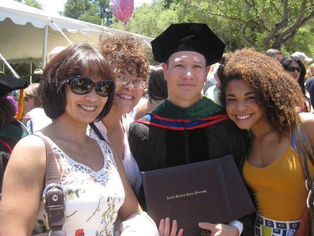 Dr. Clarke and his proud family at Stanford's graduation