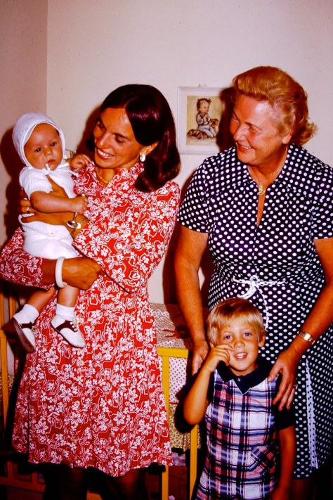 1974: Jan holds me proudly while the agency lady smiles at having sold another baby! Doug wipes away tears after realizing the agency lady was wrong - I am the new favorite.