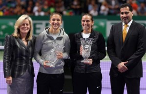 (L-R) WTA Chairman & CEO Stacey Allaster, world No.1 ranked Victoria Azarenka and Senior Vice President of Corporate Communications at Dubai Duty Free Salah Tahlak, with the year-end singles No.1 trophy at the TEB BNP Paribas WTA Championships - Istanbul.  (Photo courtesy of the WTA by Julian Finney/Getty Images)