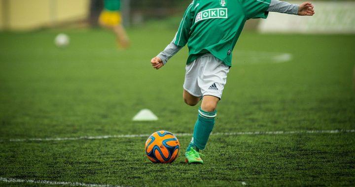 Kid kicking ball