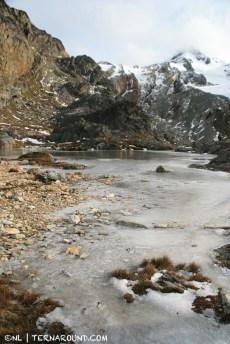 Frozen mountain laguna on the rocks
