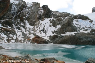 The idyllic Alvear' glacial laguna and the cave visible at the end