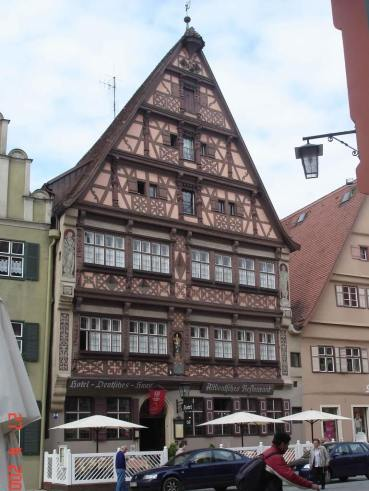 "Dinkelsbuhl-""Deutsche-Haus"" beautiful half-timbering design work,  a late Renaissance facade and decorative statues-c"