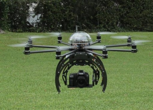 Drone carrying a camera for aerial photography