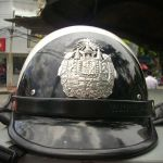 Bangkok police to expel officer found with drugs and gun at rally site