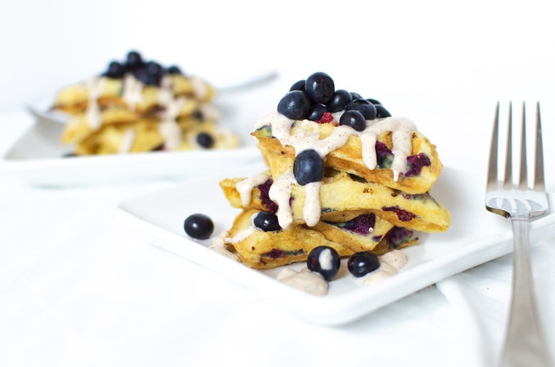 Who wouldn't want to wake up to these fluffy blueberry waffles?! Drizzle the frosting when they're still super-hot, and enjoy with more fresh blueberries.