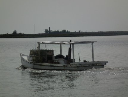 A crabber's workboat heads out from Crisfield, Md. THE CHESAPEAKE TODAY photo