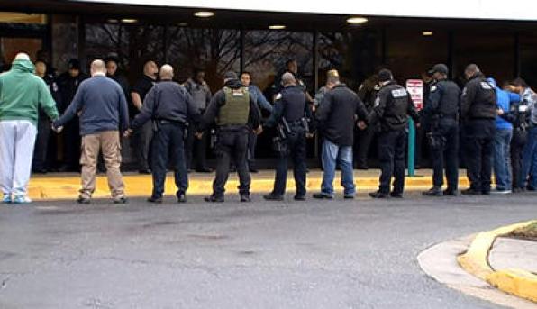 Officer shot 2 in custody in PG County 031316
