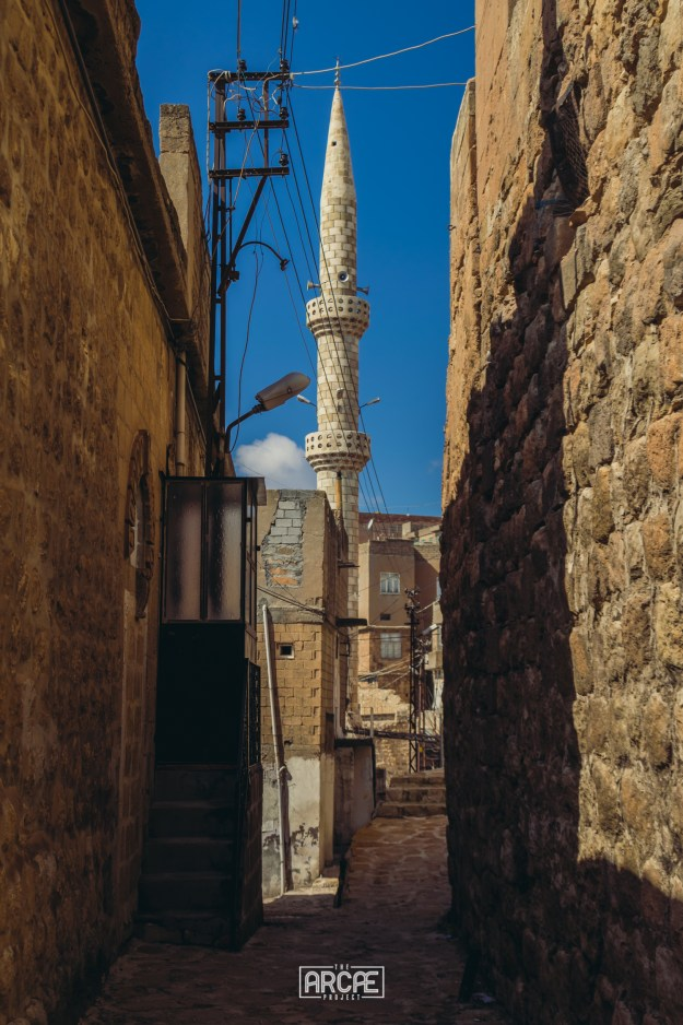 A minaret coming from top of a mosque