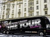 The Tour as it rides by the Dakota Apartments