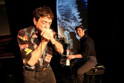 """Bob Baldori on harmonica and Arthur Migliazza at the piano in a scene from """"Boogie Stomp!"""" (Photo credit: Rebecca Scheckman)"""
