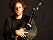 Matthew Welch with bagpipes