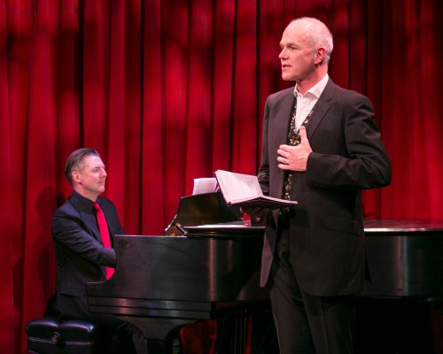 """David Shrubsole (on piano) and Simon Green in a scene from """"Life is for Living: Conversations with Coward"""" (Photo credit: Heidi Bohenkamp)"""