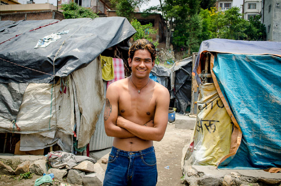Young man that lives in the tent city, Kathmandu, Nepal