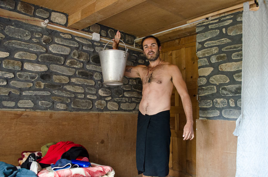 Adrian holding up a bucket he used for his shower on the Annapurna Circuit